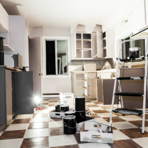 Kitchen renovation with clutter on the floor
