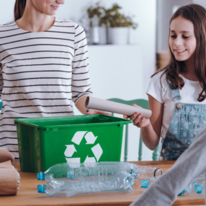Family recycling waste at home