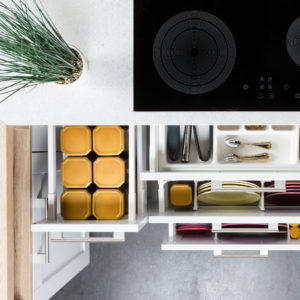 Top view of organized kitchen drawers and electric kitchen stove using konmari method