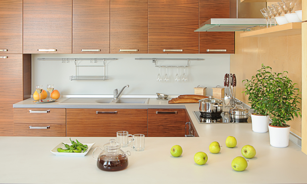 Minimalist zen kitchen with woody bamboo coloured design cabinets