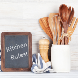 Kitchen rules on a chalkboard with kitchen utensils