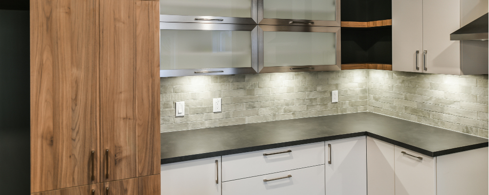 Elegant backsplash illuminated by undercabinet lighting