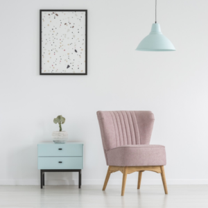 Small furniture in pastel colours on white backdrop