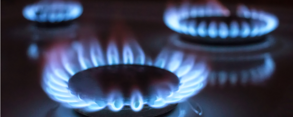 Blue gas flames on kitchen stove