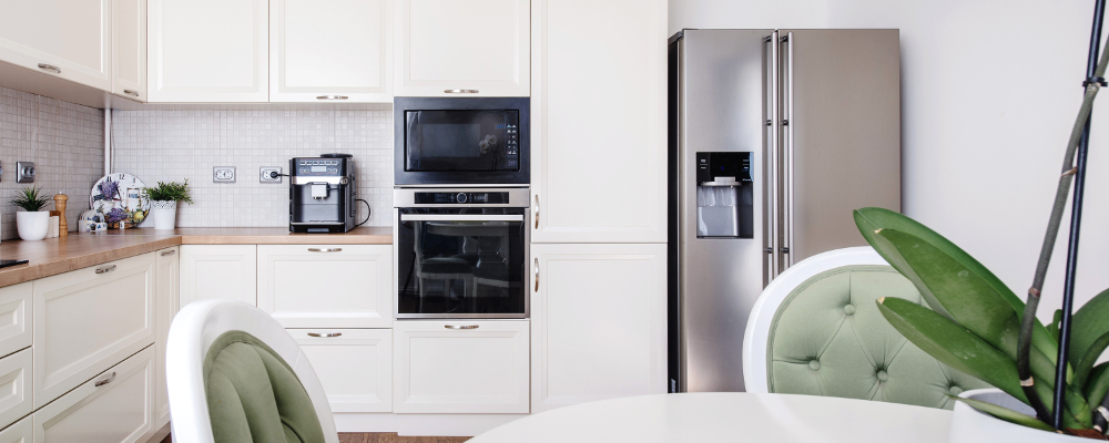 Modern kitchen area and wooden floor with modern energy saving refrigerator