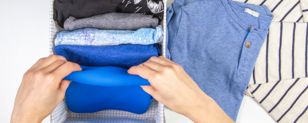 The art of folding clothes and storing upright using konmari method