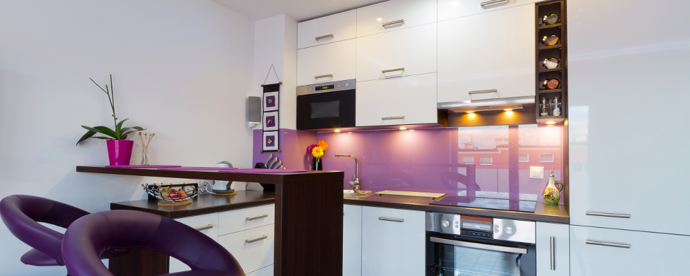 Neat and organized modern kitchen in purple and white colour scheme