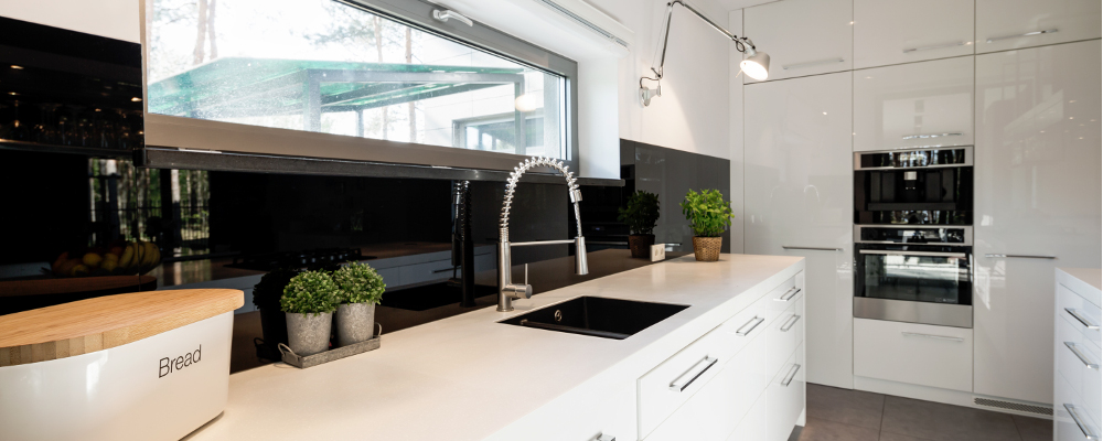 White theme kitchen with commercial style kitchen faucet