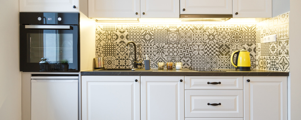 White Kitchen Cabinets with Vintage Tile Backsplash