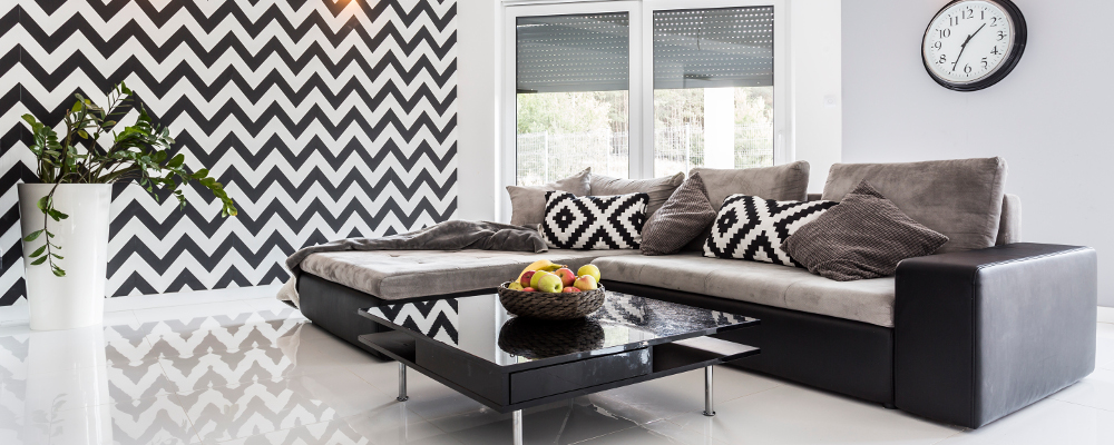 Modern living room with monochrome wallpaper and tiled flooring