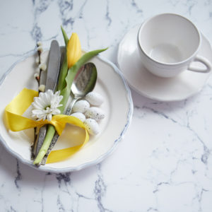 Easter plate setting on white quartz countertop