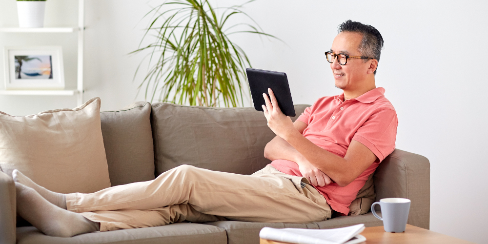 Single and elderly man enjoying a restful time on sofa