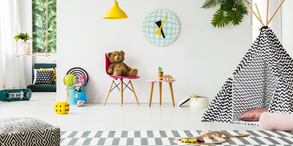 Patterned tent in kid's room interior with teddy bear against white wall with clock and lamps