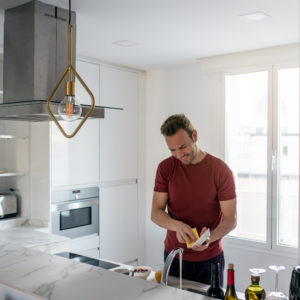 Man washing dishes in a modern kitchen