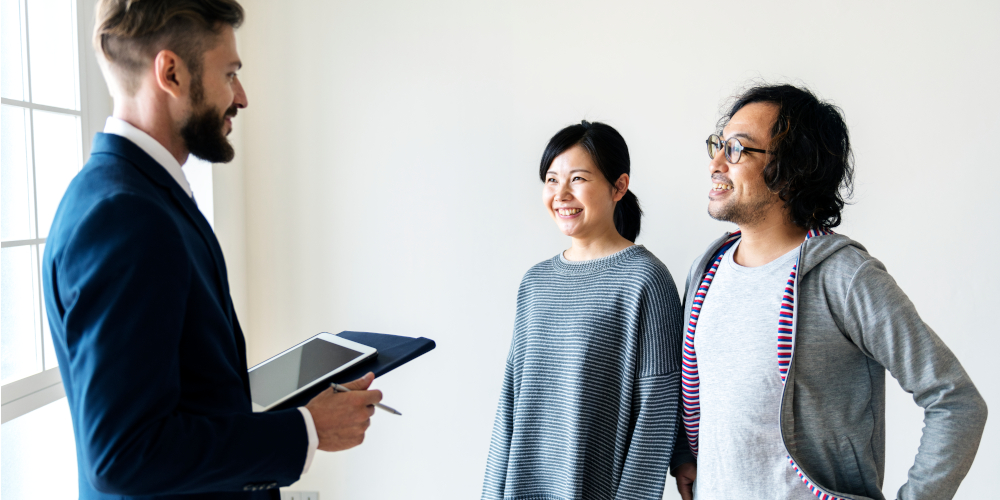 Asian couple buying new house