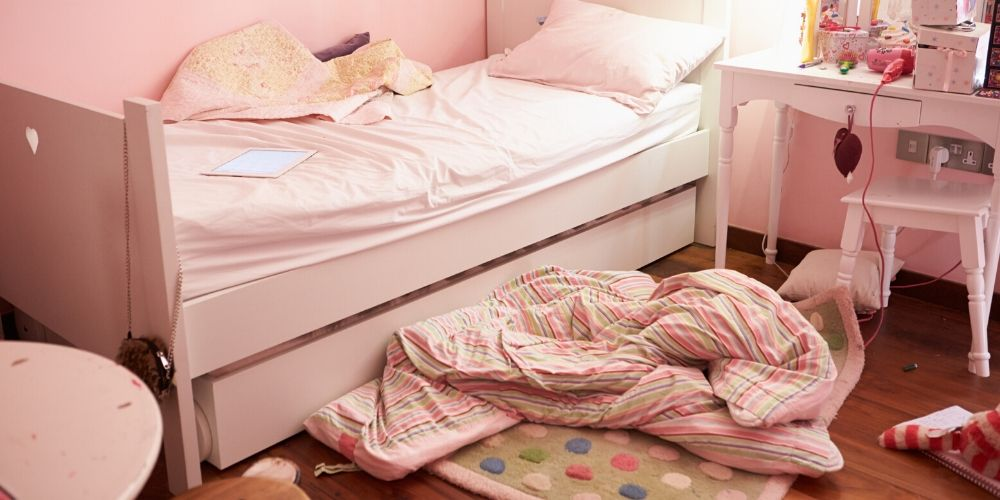 Messy child's bedroom in pink colour
