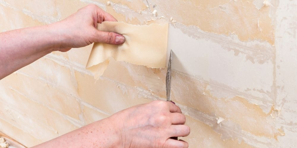 Removing old wallpaper backing from the wall