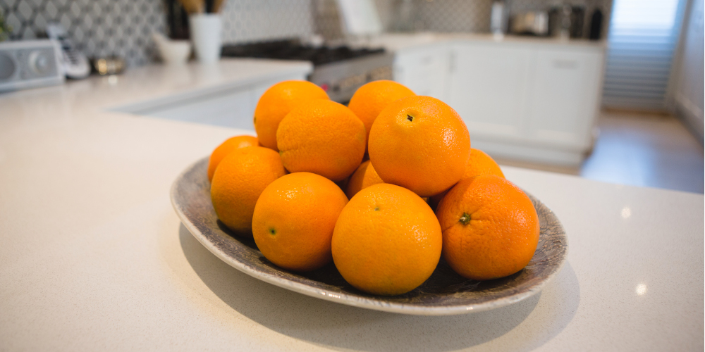 Fresh oranges on the kitchen countertop