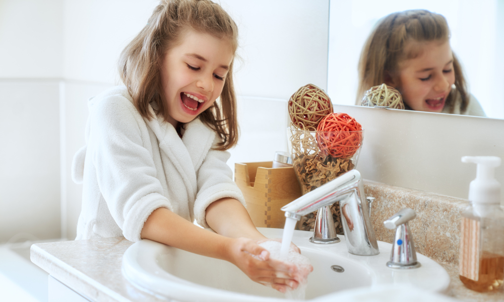 Little girl washing hands for hygienic purposes