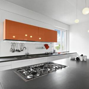 Modern kitchen interior with bright orange wall cabinet, dark coloured Silestone quartz countertop with Suede texture