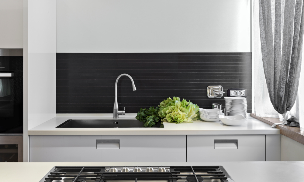 Undermount sink with vegetables on the top in the modern kitchen countertop