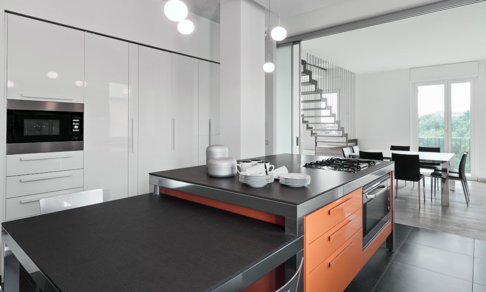 Elongated kitchen island with dining table extension