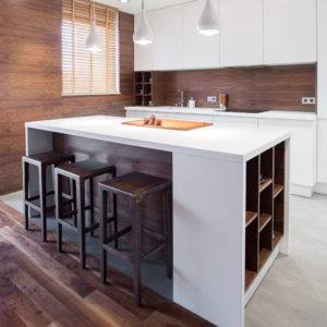 Modern white kitchen island with dark wooden accents