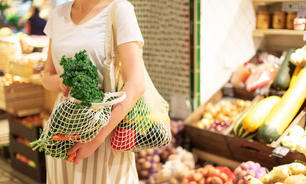 Lady carrying reusable bag while shopping for groceries