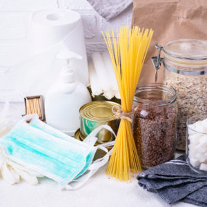 Set of products for the coronavirus pandemic. Buckwheat, rice, pasta, toilet paper, masks and antiseptic