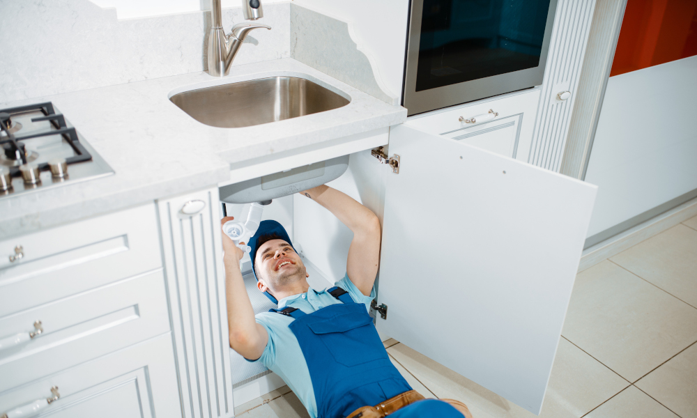 Plumber installing a new drain for the sink