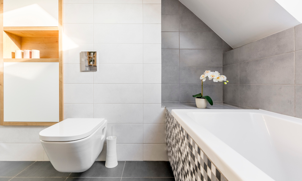 Attic bathroom in grey and white with bathtub and toilet