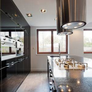 Modern luxury kitchen area made in dark tones