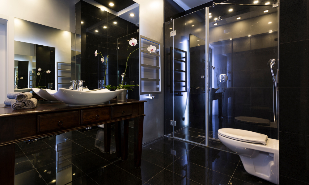 Luxurious bathroom interior with shower and dark tiles