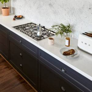 I shaped kitchen layout with white Dekton countertop and quartz backspash