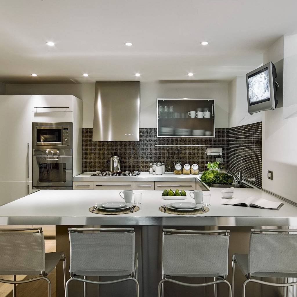 interior shot of modern kitchen with kitchen island and wood floor