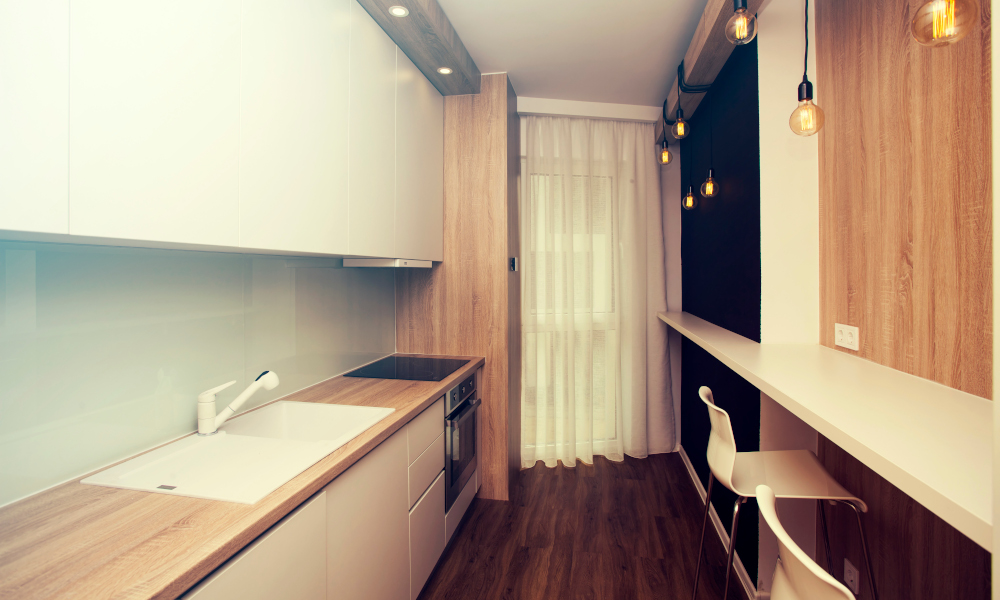 Small, white kitchen room interior with dining and cooking space
