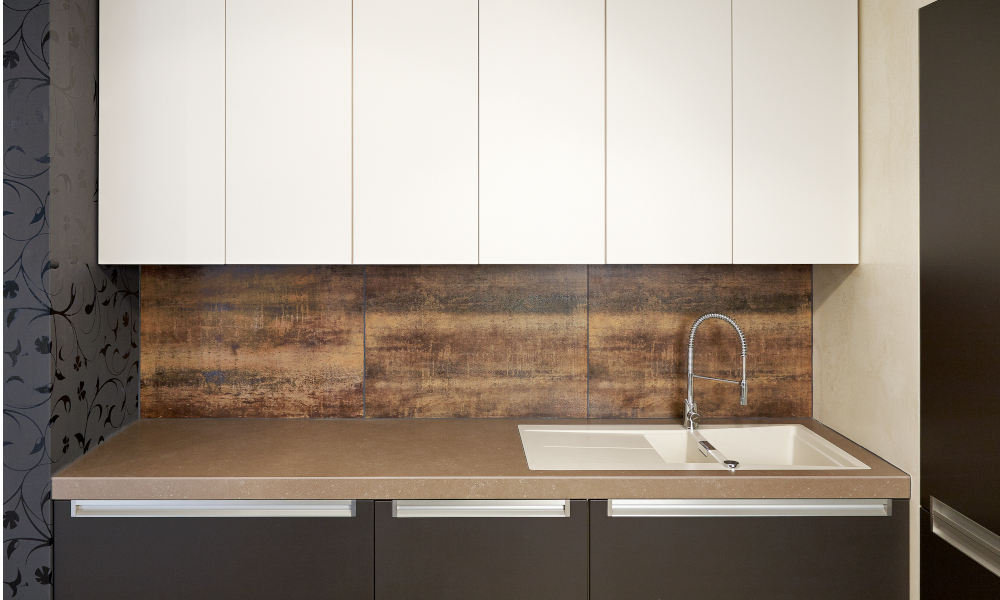 Counter and cabinets in modern kitchen with a timber design backsplash