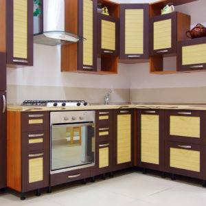 Wooden kitchen cabinets in brown and yellow theme