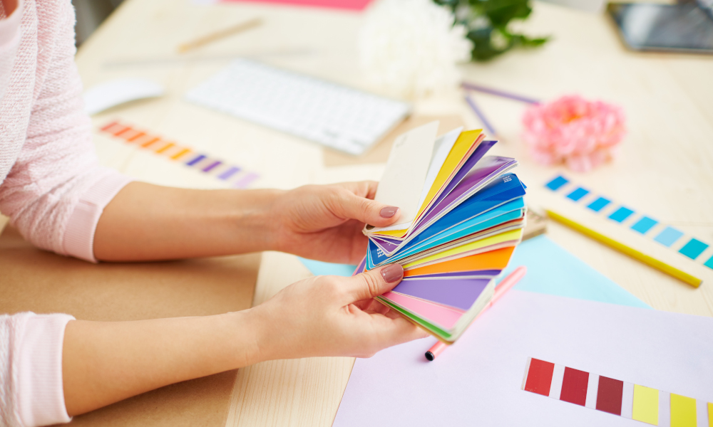 Homeowner selecting wall paint colour from colour swatches