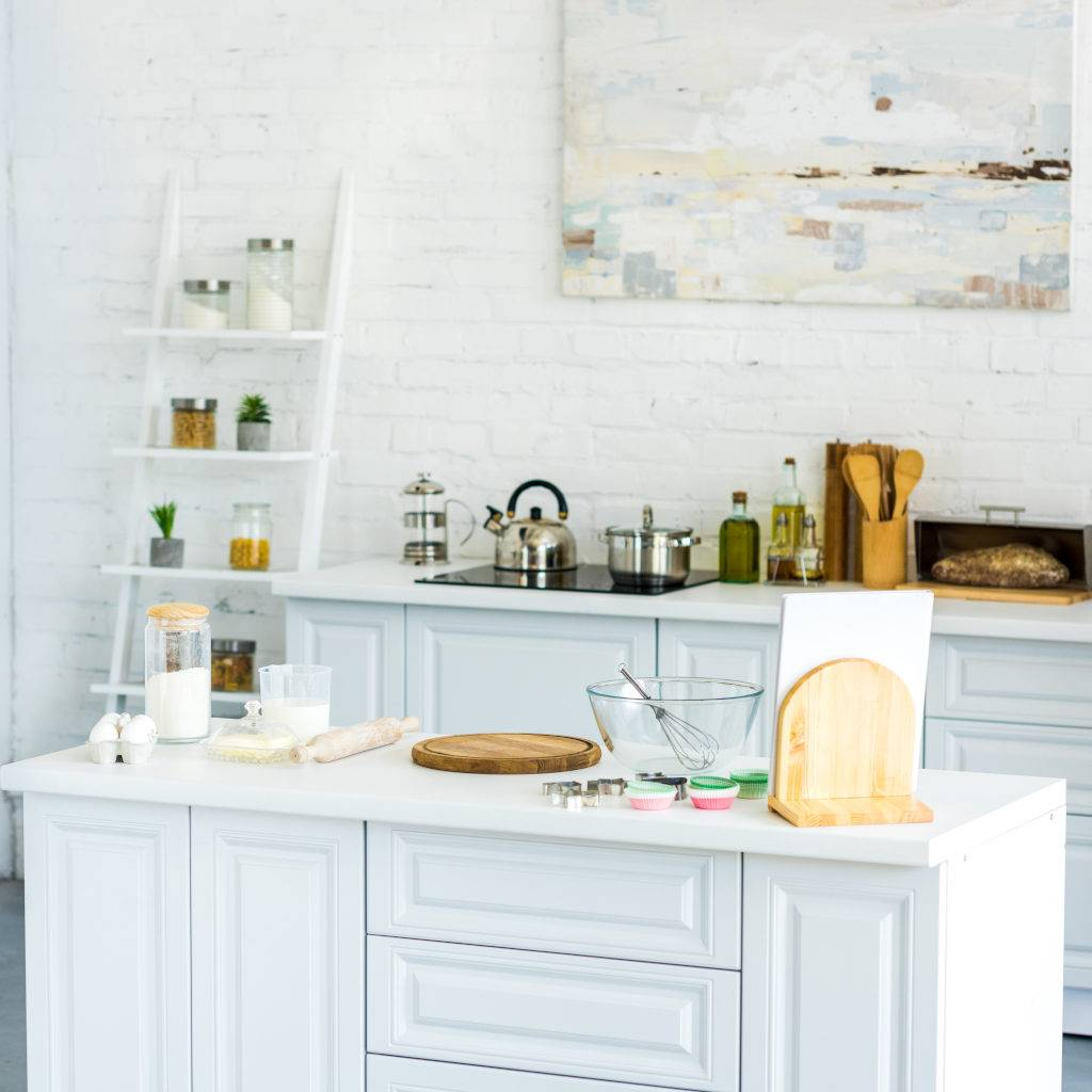 Interior of light modern kitchen with paint on wall