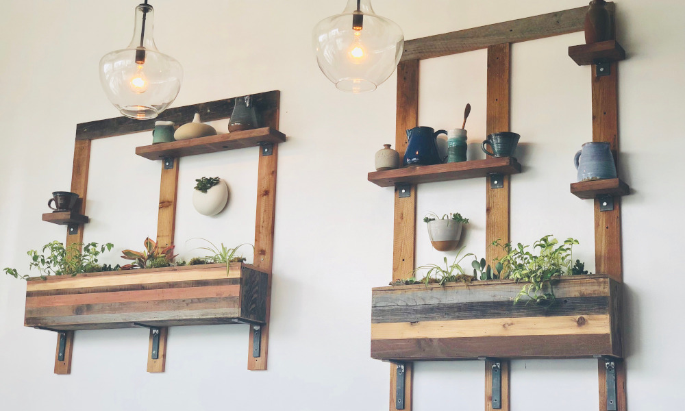 Mounted wall planters with fresh herbs for indoor kitchen decor