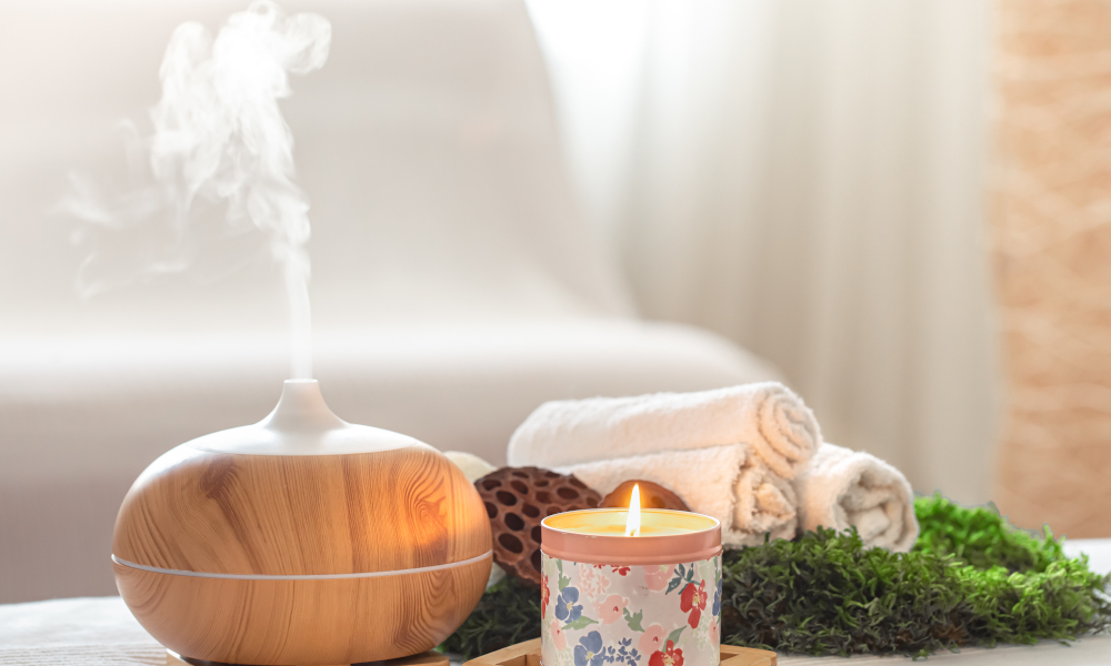 Spa composition with the aroma of a modern oil diffuser with body care products . Twisted white towels, spring greens and flowers. Spa concept for body and healthcare.
