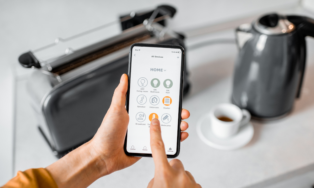 Controlling smart kitchen appliances using mobile phone at home, IoT concept