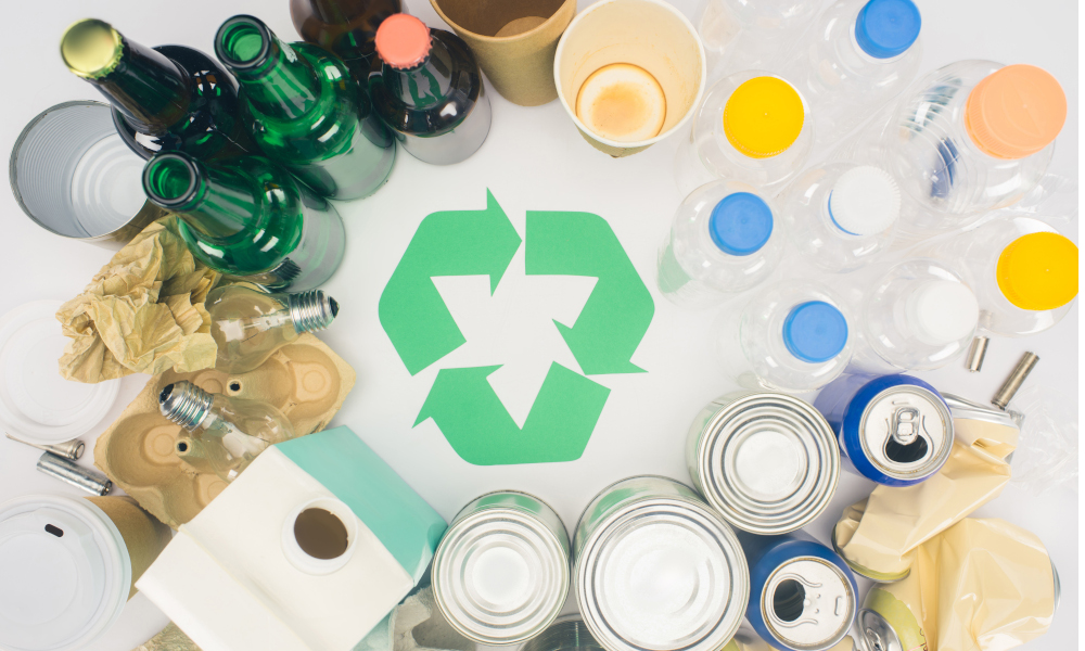 Types of recyclable items - glass bottles, aluminum tins, paper cups, plastic containers
