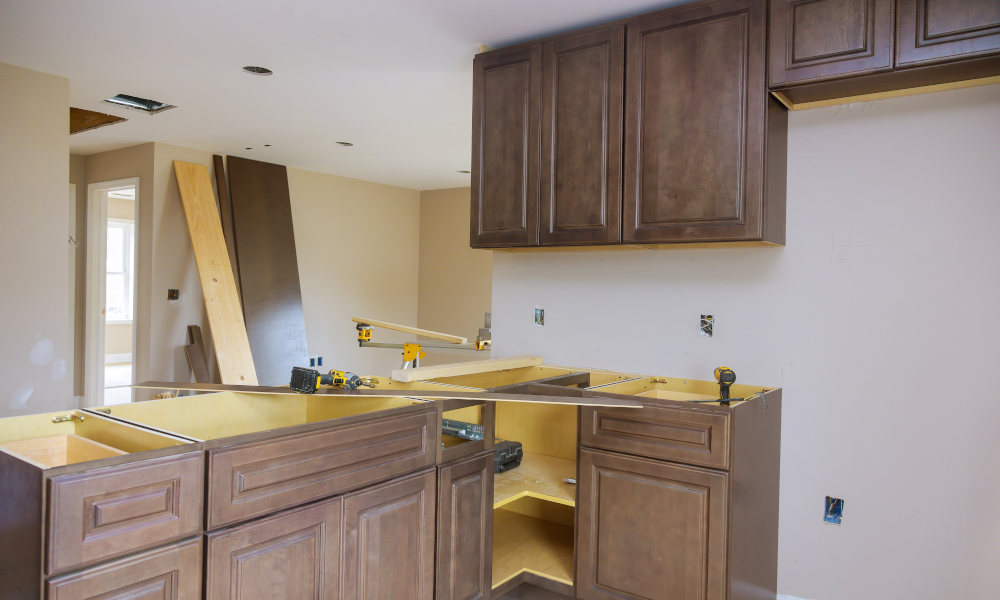 Furniture assembling of custom new cabinets in modern kitchen