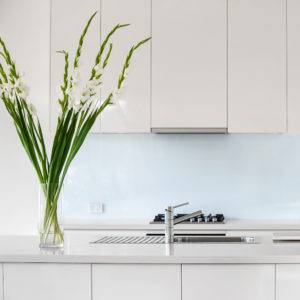 Clean and modern kitchen with decorative lily flowers