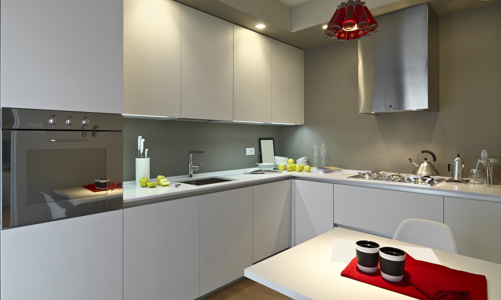 Modern kitchen layout with white cabinets and quartz countertops