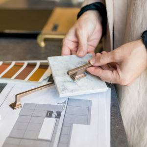 Woman choosing countertop material and kitchen fixtures