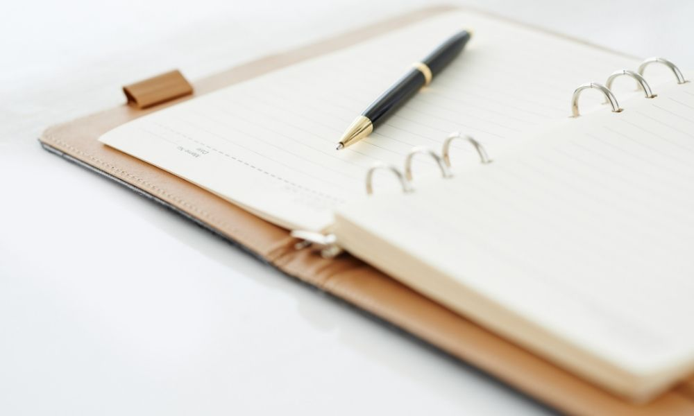 Personal organiser and pen to write down appointments