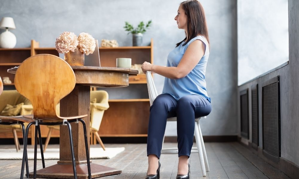 Woman sitting on chair doing a twist